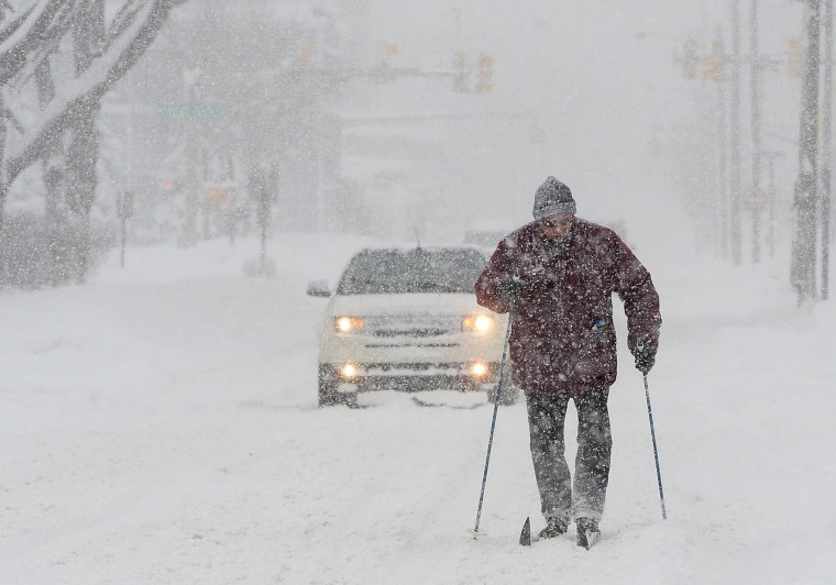 Image: Timothy Gigone, 51, of Erie, Pennsylvania, skis south on Sassafras Street