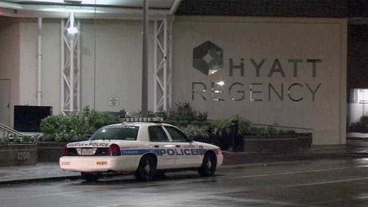 Image: A police car sits outside the Hyatt Regency hotel in Houston