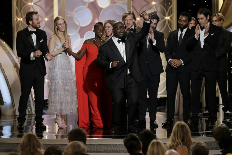 Image: Steve McQueen celebrates after winning Best Motion Picture, Drama at the 71st annual Golden Globe Awards in Beverly Hills