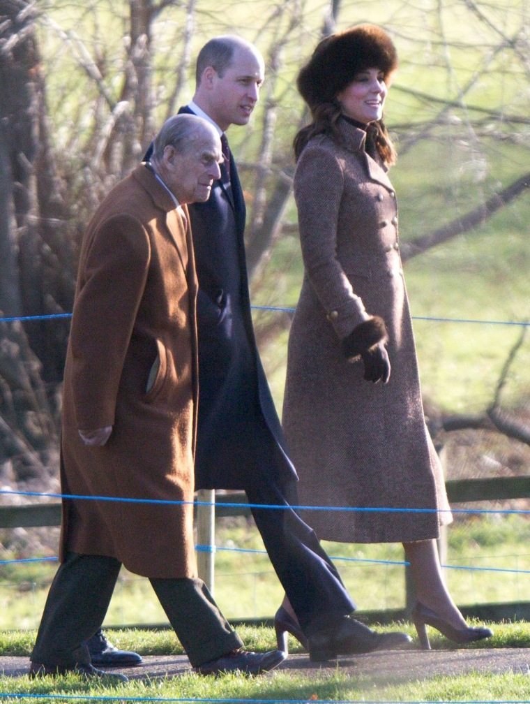 Kate, Duchess of Cambridge, wears a fur hat while walking with Prince William
