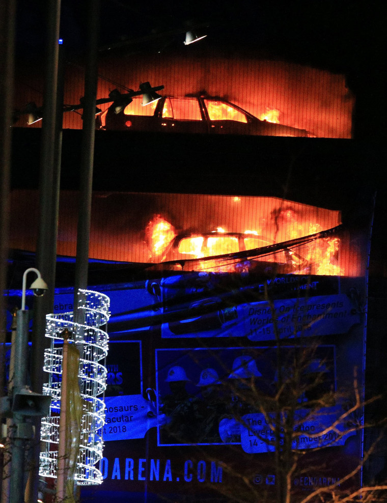 Image: Cars are seen on fire during a serious blaze in a multi-storey car park in Liverpool, Britain.
