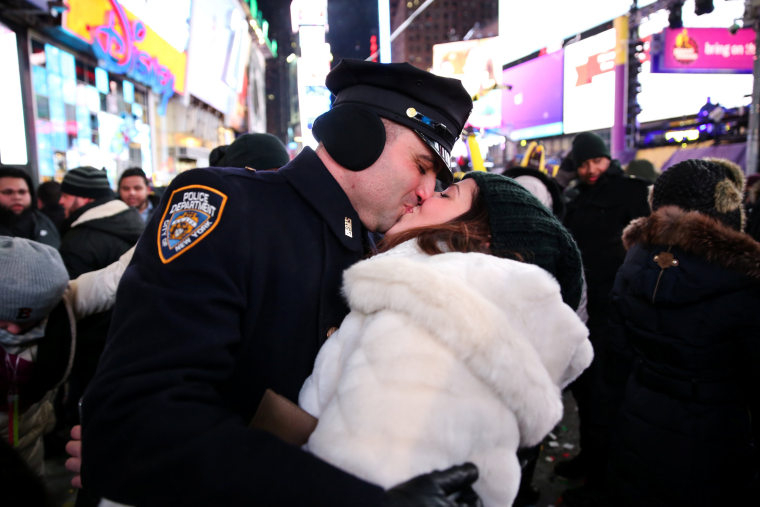 Image: A couple kisses while they celebrate the New Year in Times Square in New York