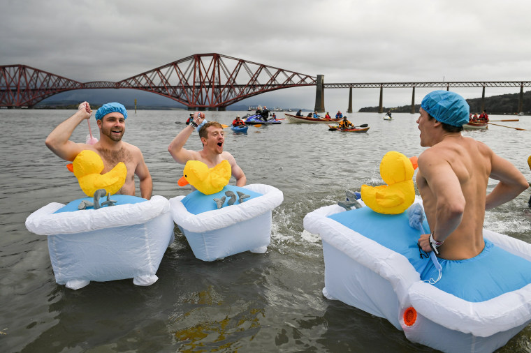 Image: New Year's Day Bathers Take Part In The Loony Dook Swim