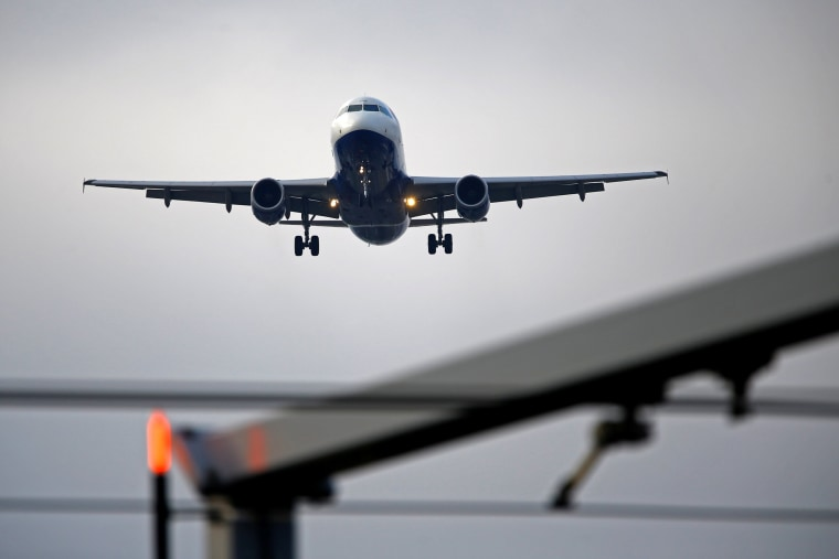Image: An airplane prepares to land at Cointrin airport in Geneva