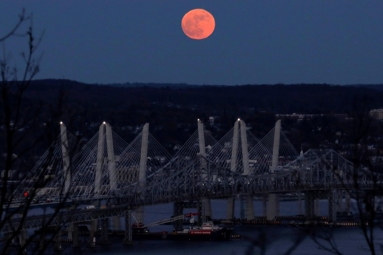 Image: A 'supermoon' full moon is seen above the Hudson River and the Mario M. Cuomo Bridge from Nyac
