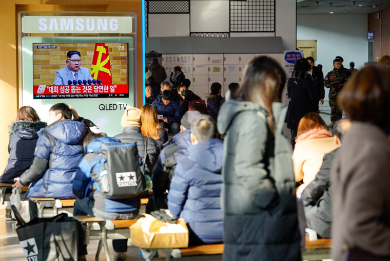 Image: South Koreans in Seoul's main train station watch Kim Jong Un address