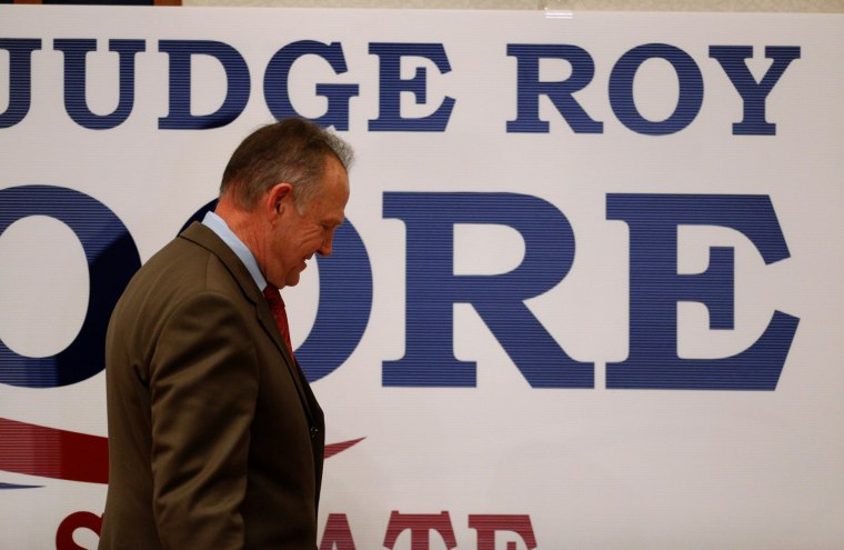 Image: Republican U.S. Senate candidate Roy Moore exits the stage after addressing supporters at his election night party in Montgomery