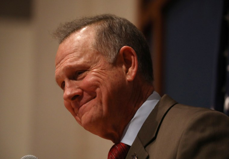 Image: Republican U.S. Senate candidate Roy Moore pauses as he addresses supporters at his election night party in Montgomery