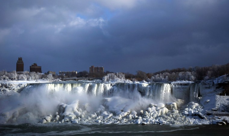 Image: Water flows over the American Falls as ice forms in Niagara Falls