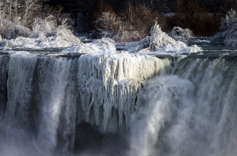 Image: Water flows over the American Falls as viewed from the Canadian side