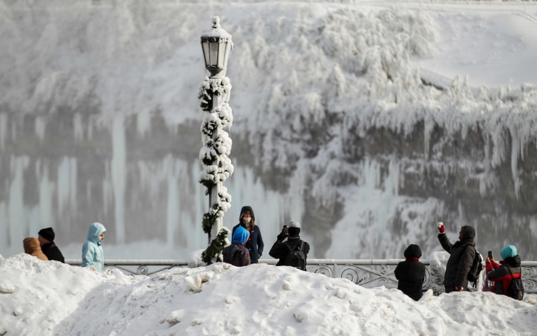 Image: Tourists take photos of the Horseshoe Falls in Niagara Falls