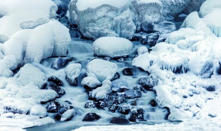 Image: Rocks are covered in ice at the base of the American Falls