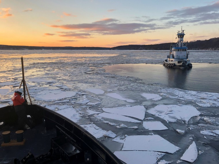 Image: U.S. Coast Guard Cutter Penobscot Bay helps break free tug Stephanie Dann from the ice on the Hudson River near Kingston