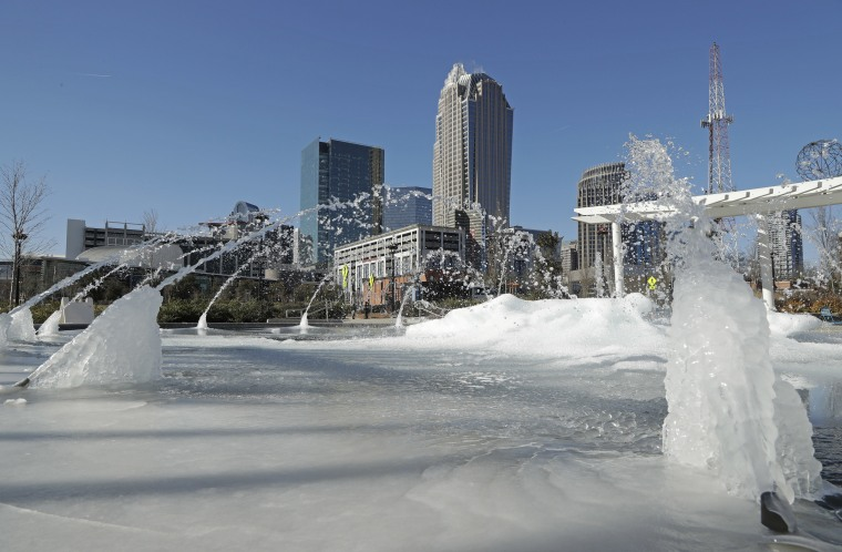 Image: Water squirts from a frozen fountain near downtown in Charlotte