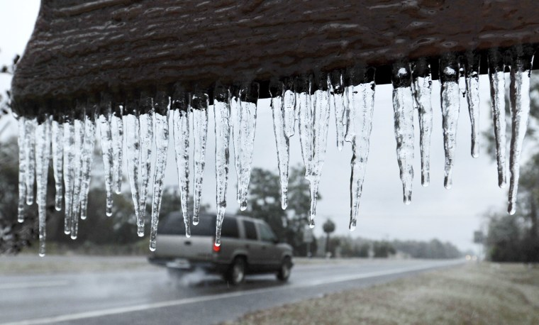 """Image: Icicles hang from the """"Welcome to Hilliard sign"""" in Hilliard,"""