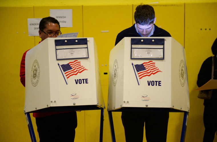 Image: Voters cast ballots in the 2016 U.S. presidential election