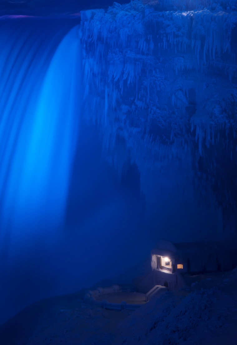 Image: A building covered in ice sits at the base of the Horseshoe Falls in Niagara Falls