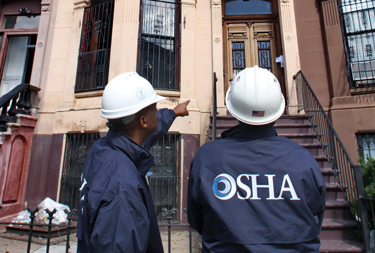 Image: OSHA inspectors survey homes that lost roofs