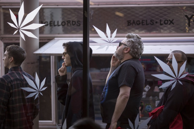 Image: People stand in line to get into MedMen, one of the two Los Angeles area pot shops that began selling marijuana