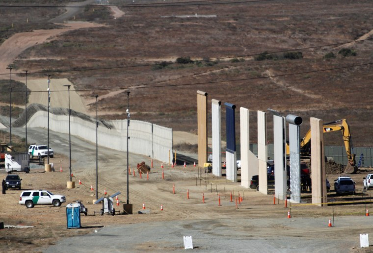 Image: Prototypes for U.S. President Donald Trump's border wall with Mexico are shown near completion in this picture taken from the Mexican side of the border, in Tijuana
