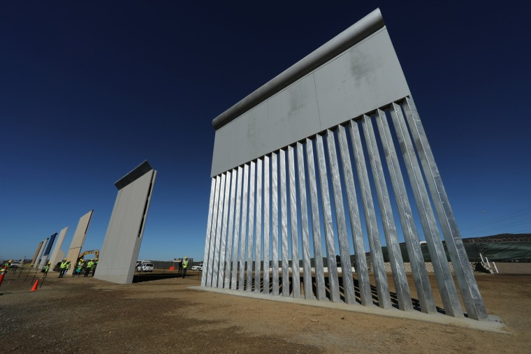 Image: Seven of U.S. President Donald Trump's eight border wall prototypes are shown near completion along U.S.- Mexico border near San Diego