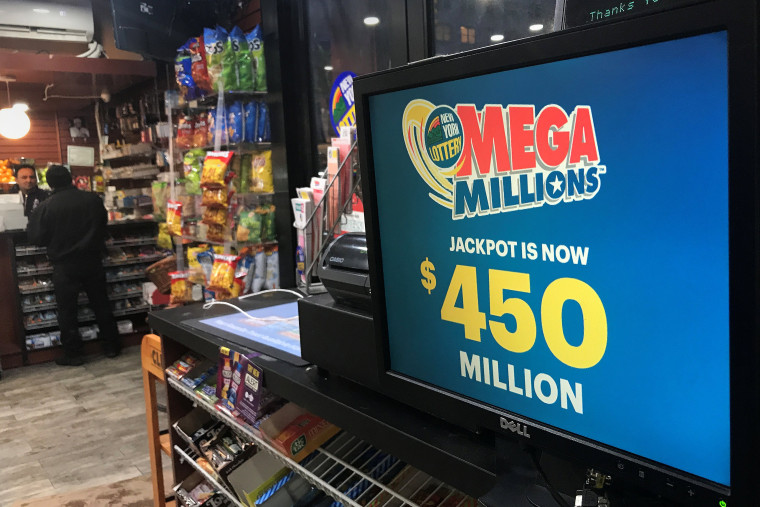 Image: A Mega Millions sign is pictured in a store in New York City