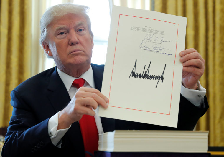 Image: U.S. President Trump displays signature after signing tax bill into law at the White House in Washington