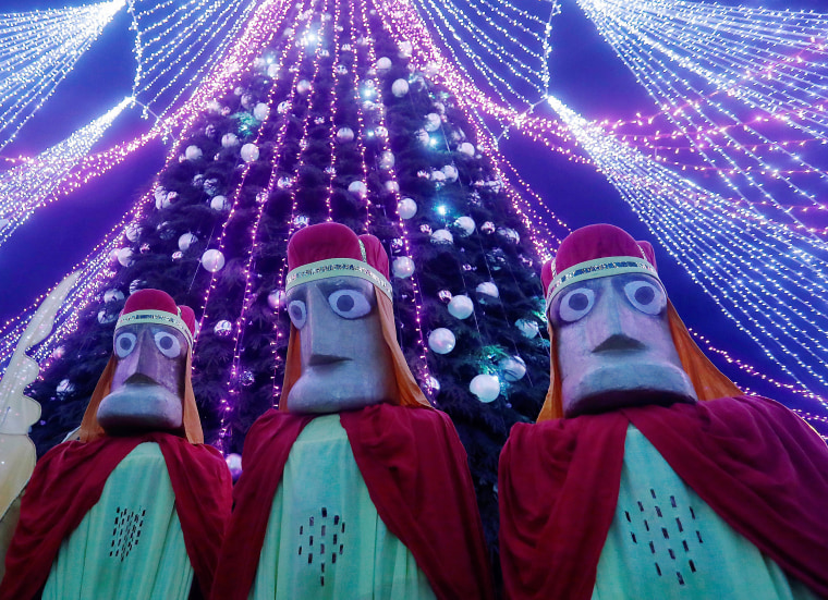 Image: People dressed as the Three Kings parade through the streets during the Epiphany Day celebrations in Vilnius