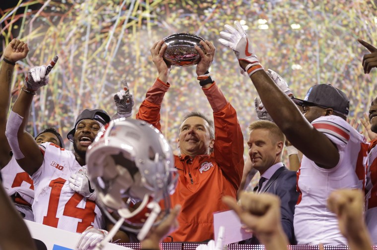 Image: Ohio State Buckeyes head coach Urban Meyer holds the trophy after defeating Wisconsin in the Big Ten championship game on Dec. 3, 2017.