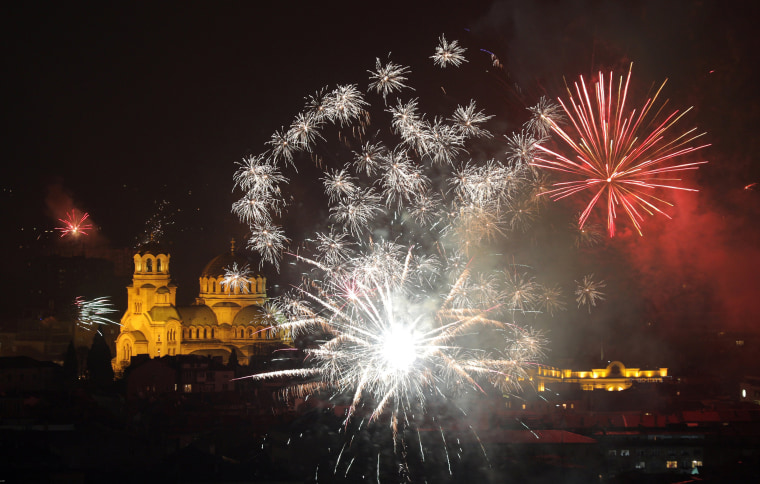 Image: Fireworks explode over the Alexander Nevski cathedral during the New Year celebrations in Sofia