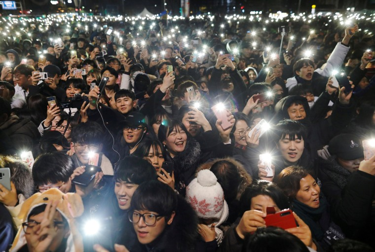 Image: People attend a ceremony to celebrate the new year in Seoul