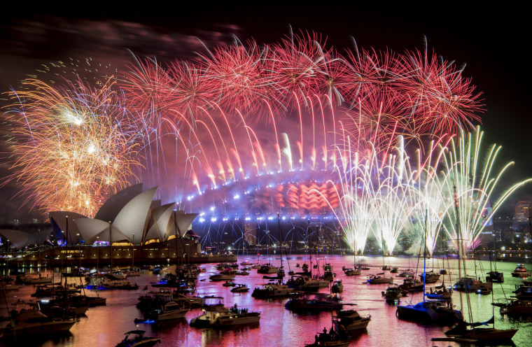 Image: Fireworks explode over the Sydney Harbour during New Year's Eve celebrations in Sydney