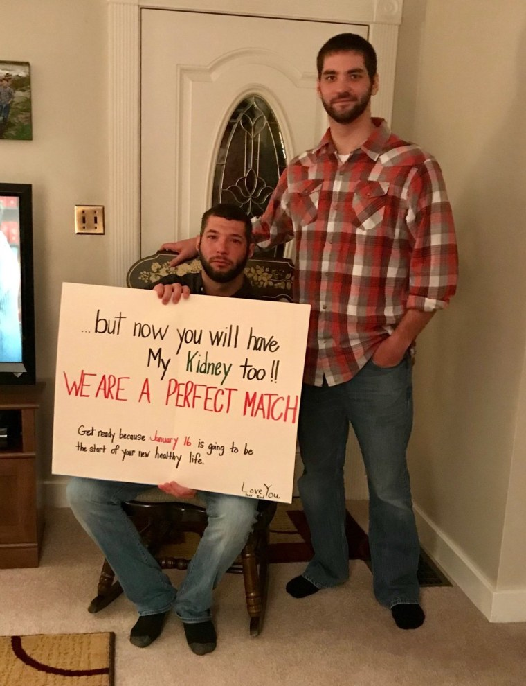 Brandon and Derek pose with Brandon's surprising birthday card.