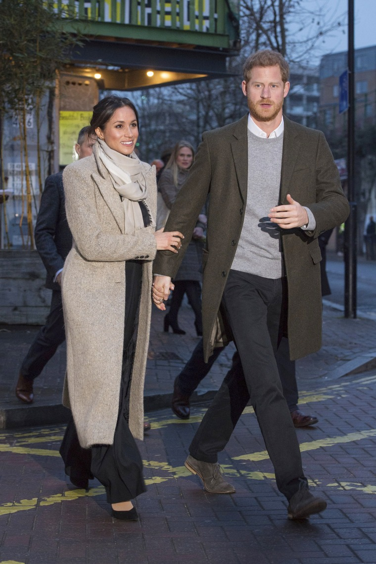 Britain's Prince Harry, right, and his fiancee Meghan Markle leave after a visit to the Reprezent 107.3 FM radio station in Brixton, in London, on Jan. 9, 2018. She wore an camel-colored coat from Smythe brando, a Marks & Spencer wool blend round neck bell sleeve sweater, black trousers from Burberry and Sarah Flint Tortoisehell heel pumps.
