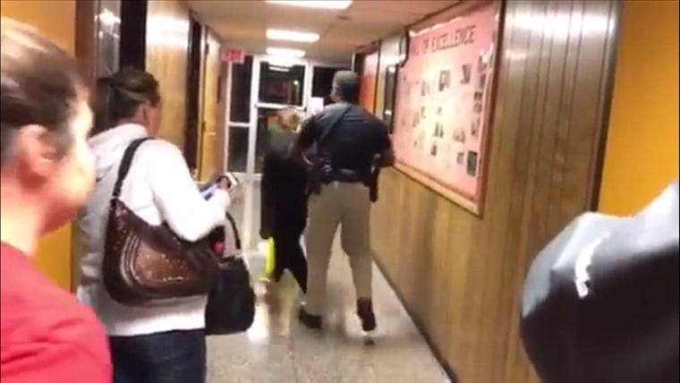 A marshal throws Deyshia Hargrave out of Vermilion Parish School Board's meeting on Monday.