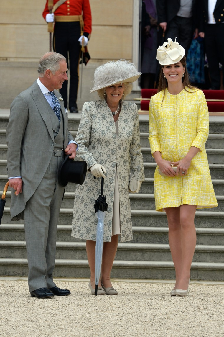 Prince Charles, the Prince of Wales (L), Camilla, the Duchess of Cornwall (C) and Catherine, the Duchess of Cambridge attend a Garden Party in the grounds of Buckingham Palace, central London on May 22, 2013.