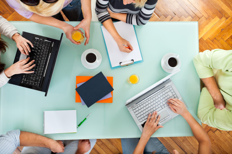 Image: Group of people with two laptops at a meeting