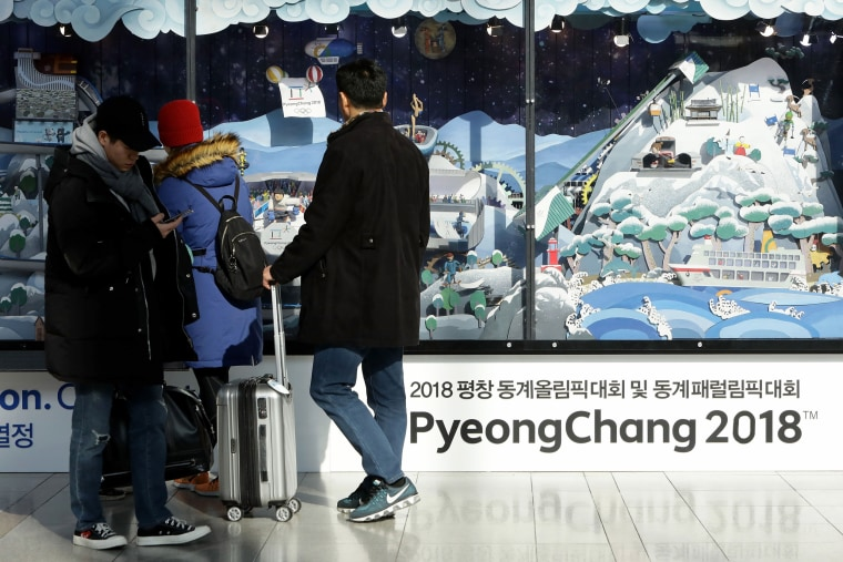 Image: People watch the 2018 PyeongChang Winter Olympic and Paralympic Games PR booth on Jan. 5, 2018 in Seoul, South Korea.