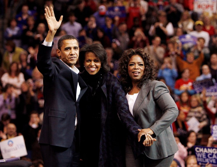 Image: Democratic presidential candidate U.S. Senator Obama his wife Michelle and entertainer and talk show host Oprah wave in Manchester