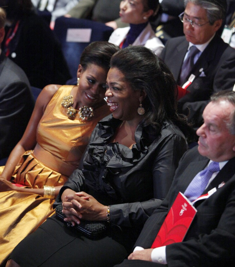 Former First lady Michelle Obama sits with Oprah Winfrey and Chicago Mayor Richard Daley at the opening ceremonies of the the International Olympic Committee (IOC) Session in 2009.