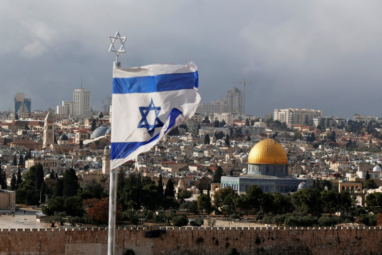 Image: FILE PHOTO: An Israeli flag is seen near the Dome of the Rock, located in Jerusalem's Old City on the compound known to Muslims as Noble Sanctuary and to Jews as Temple Mount