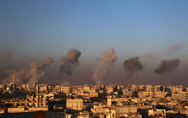 Image: Smoke rises from buildings following air strikes in Arbin
