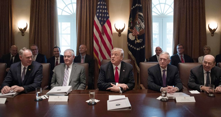Image:  President Donald Trump, center, speaks during a cabinet meeting at the White House