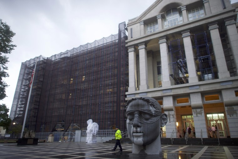 Image: A security officer walks in front of the Martin Luther King Building and U.S. Courthouse in Newark