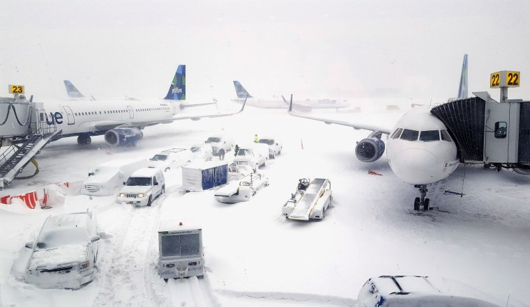 Image: Airplanes wait at the gates outside terminal five at John F. Kennedy International Airport