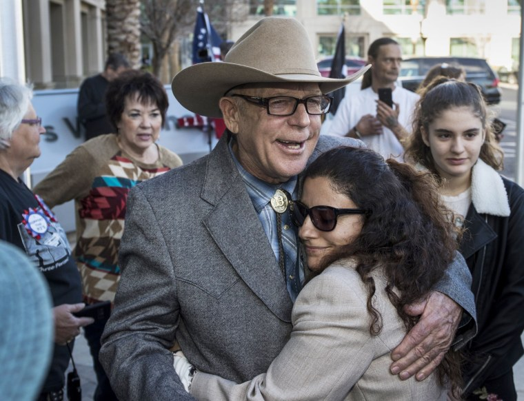 Image: Cliven Bundy hugs Maysoun Fletcher, an attorney for his son Ryan