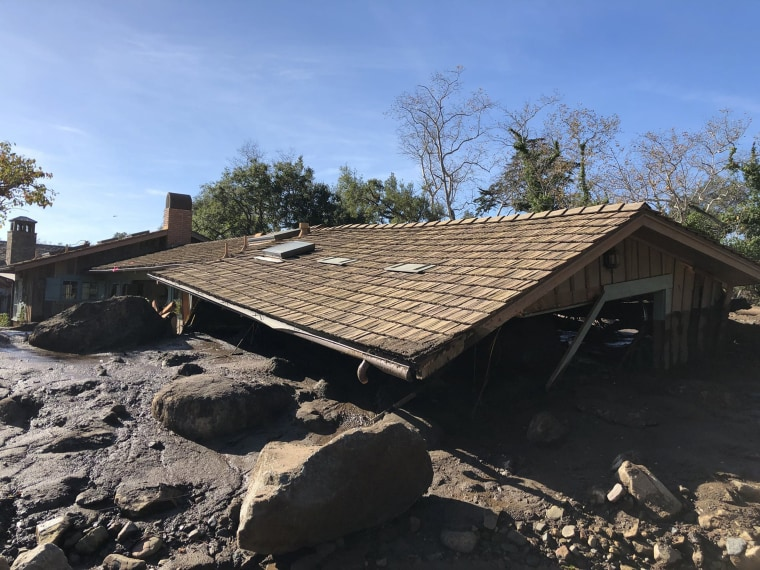 Image: Mudflow, boulders, and debris reach the roof of a single story home off San Ysidro Creek
