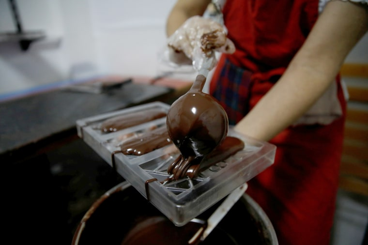 Adriana Pino makes chocolate bars at the +58 Cacao chocolate factory in Caracas