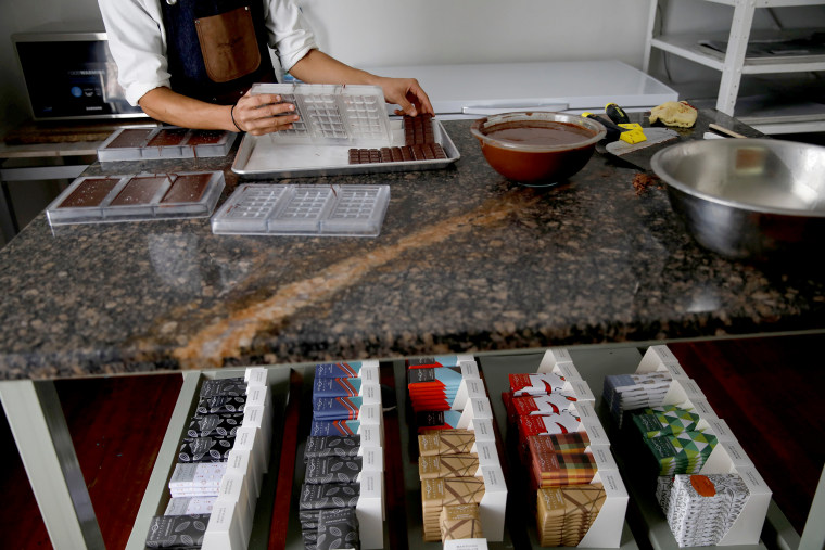 A worker makes chocolate bars at the Mantuano chocolate factory in Caracas