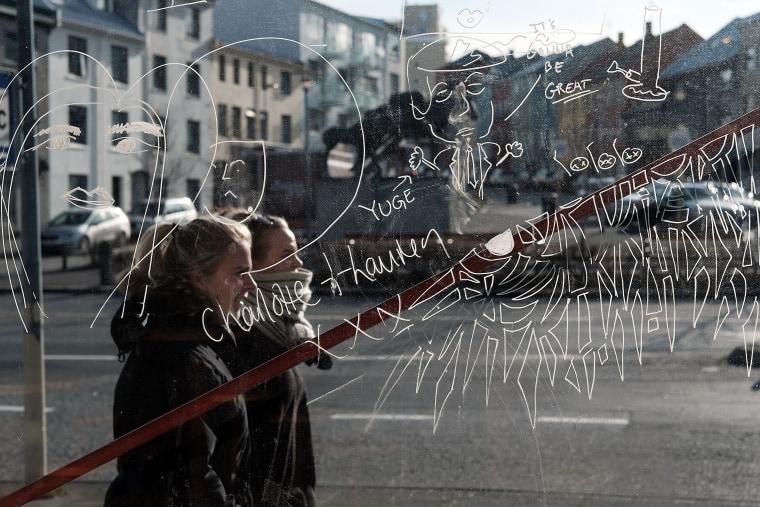 Image:  Women walk down a shopping street